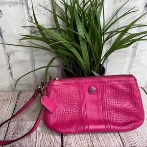 Coach hot pink eyelet leather wristlet clutch